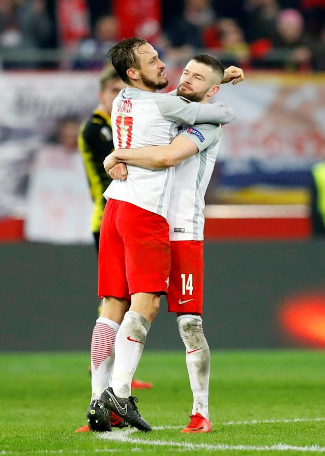 Soccer Football - Europa League Round of 16 Second Leg - RB Salzburg vs Borussia Dortmund - Red Bull Arena Salzburg, Salzburg, Austria - March 15, 2018 RB Salzburg's Andreas Ulmer celebrates with Valon Berisha after the match REUTERS/Leonhard Foeger
