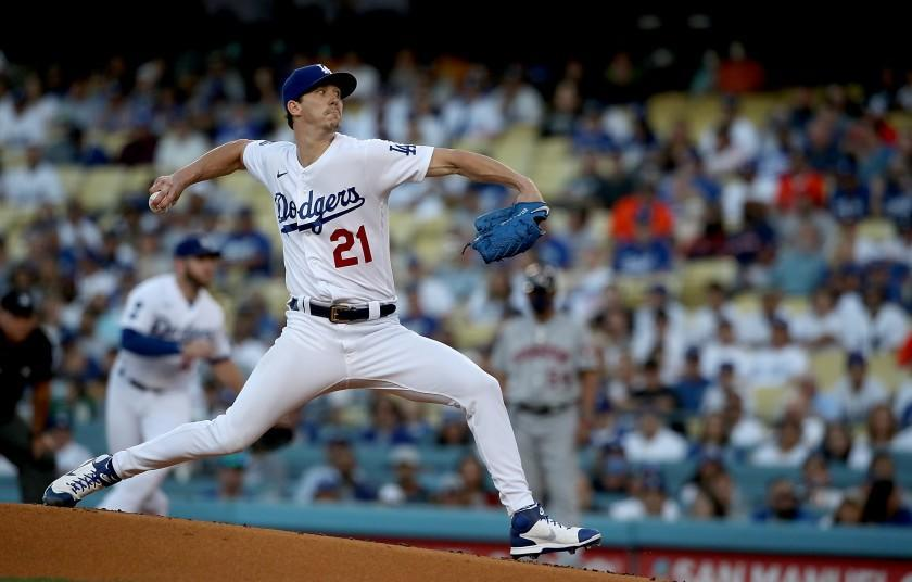 LOS ANGELES, CALIF. - AUG. 3, 2021. Dodgers starter Walker Buehler delivers a pitch against the Astros in the first inning at Dodger Stadium on Tuesday, Aug. 3, 2021. The Astros cheated by stealing signals during the 2017 World Series against Dodgers. (Luis Sinco / Los Angeles Times)