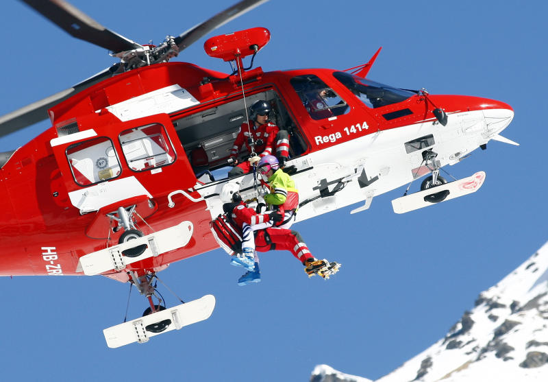 Germany's Maria Hoefl Riesch is lifted to a rescue helicopter after crashing during a women's alpine skiing downhill at the World Cup finals in Lenzerheide, Switzerland, Wednesday, March 12, 2013. (AP Photo/Marco Trovati)