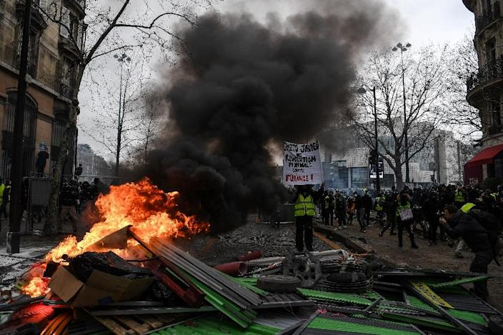 'Yellow vests = World revolution against finance!' There were clashes during the protests at Place de la Bastille in Paris (AFP Photo/Christophe ARCHAMBAULT)