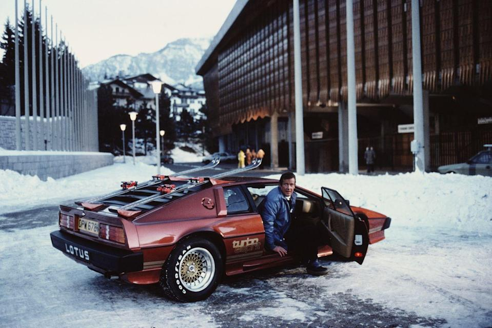 <p>Roger Moore gets out of a Lotus Esprit Turbo, on the set of the James Bond film 'For Your Eyes Only' in Cortina d'Ampezzo, Italy, March 1981. </p>