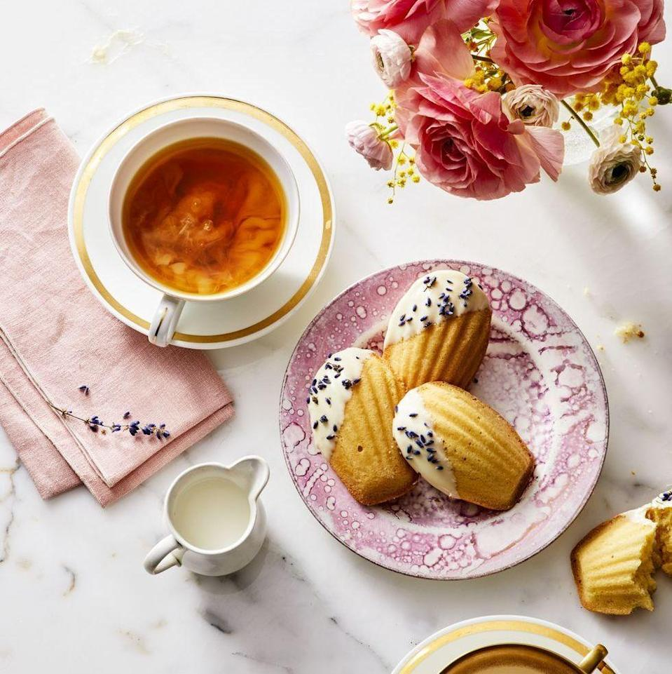 """<p>These precious cookies are sure to turn your after-dinner tea into a meal of its own.</p><p><em><a href=""""https://www.goodhousekeeping.com/food-recipes/dessert/a27274891/white-chocolate-and-lavender-madeleines-recipe/"""" rel=""""nofollow noopener"""" target=""""_blank"""" data-ylk=""""slk:Get the recipe for White Chocolate and Lavender Madeleines »"""" class=""""link rapid-noclick-resp"""">Get the recipe for White Chocolate and Lavender Madeleines »</a></em></p><p><a class=""""link rapid-noclick-resp"""" href=""""https://www.amazon.com/YumAssist-Nonstick-Madeleine-12-cup-Baking/dp/B07MXV7V42?linkCode=ogi&tag=syn-yahoo-20&ascsubtag=%5Bartid%7C10063.g.34851223%5Bsrc%7Cyahoo-us"""" rel=""""nofollow noopener"""" target=""""_blank"""" data-ylk=""""slk:SHOP NOW"""">SHOP NOW</a><br></p>"""