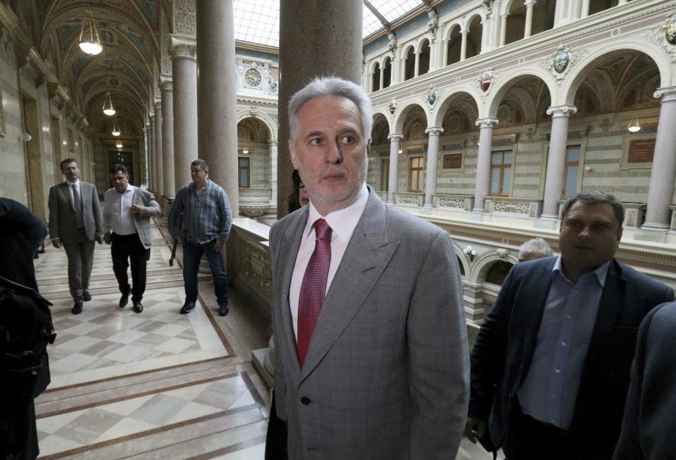 Ukrainian oligarch Dymitro Firtash arrives for the start of his trial at the Austrian supreme court in Vienna, Austria, Tuesday, June 25, 2019. Austrian supreme court rules on extradition case of Ukrainian oligarch Dymitro Firtash to the US. (AP Photo/Ronald Zak)