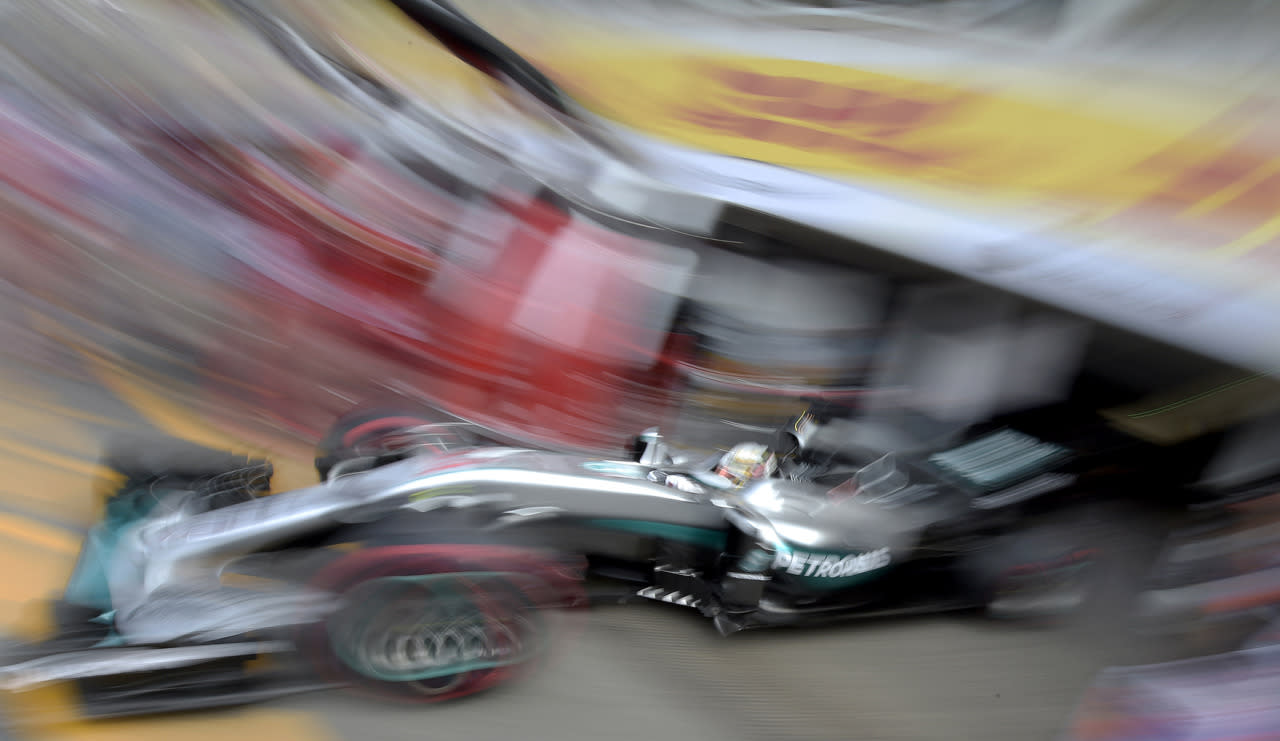 <p>In this photo taken with slow shutter speed Mercedes driver Lewis Hamilton of Britain starts for a Formula One training session in Hockenheim, Germany, July 29, 2016. (Photo: Jens Meyer/AP)</p>