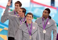 <p>Michael Phelps and teammates Adrian Nathan (L), Ryan Lochte (2nd L) and Cullen Jones ® celebrate with the silver medals won during the 4 x 100-meter freestyle relay final at the London 2012 Olympic Games on July 29, 2012. (Adam Pretty/Getty Images)</p>