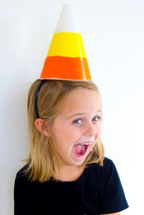 "<p>This cute candy corn hat is perfect for Halloween parties, dress-up and play time, or even to wear as part of <a href=""https://www.countryliving.com/diy-crafts/g1360/halloween-costumes-for-kids/"" rel=""nofollow noopener"" target=""_blank"" data-ylk=""slk:DIY Halloween costumes for kids"" class=""link rapid-noclick-resp"">DIY Halloween costumes for kids</a>.</p><p><strong>Get the tutorial at <a href=""https://love-the-day.com/candy-corn-craft"" rel=""nofollow noopener"" target=""_blank"" data-ylk=""slk:Love the Day"" class=""link rapid-noclick-resp"">Love the Day</a>.</strong></p><p><a class=""link rapid-noclick-resp"" href=""https://www.amazon.com/Champion-Sports-Visibility-Fluorescent-Plastic/dp/B000TVK3U2/?tag=syn-yahoo-20&ascsubtag=%5Bartid%7C10050.g.4950%5Bsrc%7Cyahoo-us"" rel=""nofollow noopener"" target=""_blank"" data-ylk=""slk:SHOP PLASTIC CONES"">SHOP PLASTIC CONES</a><br></p>"