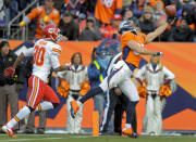FILE - In this Dec. 30, 2012, file photo, Denver Broncos wide receiver Eric Decker (87) makes a one-handed catch for a touchdown in front of Kansas City Chiefs defensive back Jalil Brown (30) in the second quarter of an NFL football game in Denver. The one-handed catch by New York Giants' Odell Beckham Jr. that became the most talked-about play from Sunday, Nov. 23, 2014, did more than just boost his standing with the New York Giants, it paid off a routine growing popular among many skill players of practicing the impractical, one-handed circus grab. (AP Photo/Jack Dempsey, File)