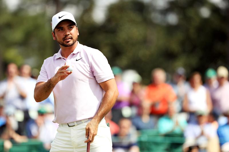 Jason Day acknowledges patrons on the 18th green during the second round of the 2019 Masters.