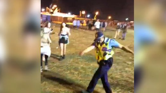 This cop cannot help busting some sick moves when the beat ...