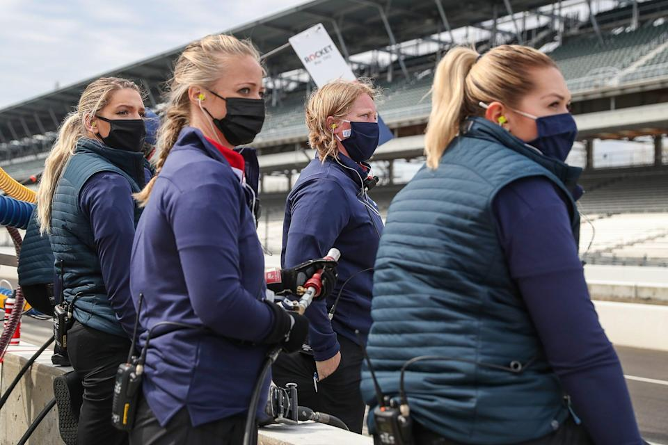 Paretta Autosport crew members wait for driver Simona De Silvestro to return to their pit during open testing for the 2021 Indianapolis 500 on April 9.