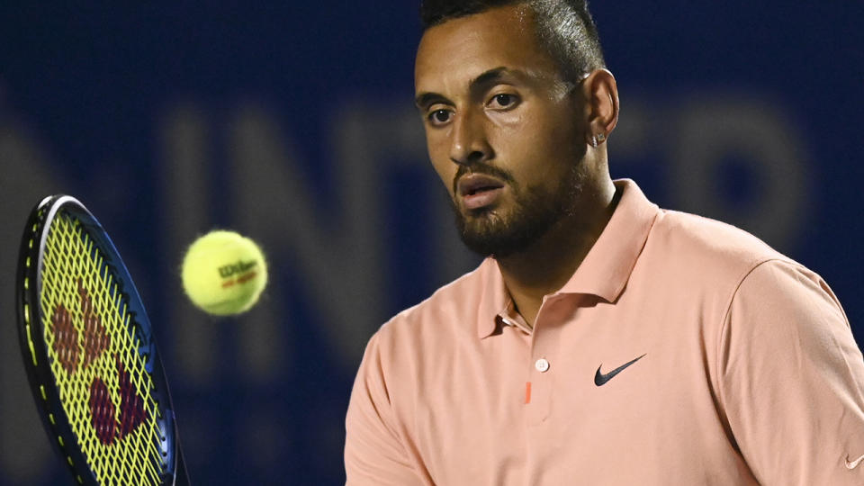 Nick Kyrgios responded angrily after he was compared to Bernard Tomic by someone on social media. (Photo by PEDRO PARDO/AFP via Getty Images)
