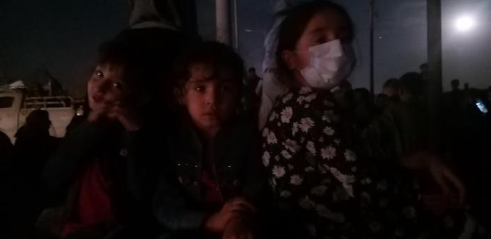 Najeeb Rahimi's three daughters wait outside the Kabul airport with their parents. August 21, 2021