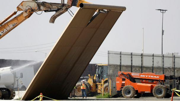 PHOTO: In this Feb. 27, 2019, file photo, a border wall prototype falls during demolition at the border between Tijuana, Mexico, and San Diego. (Gregory Bull/AP)
