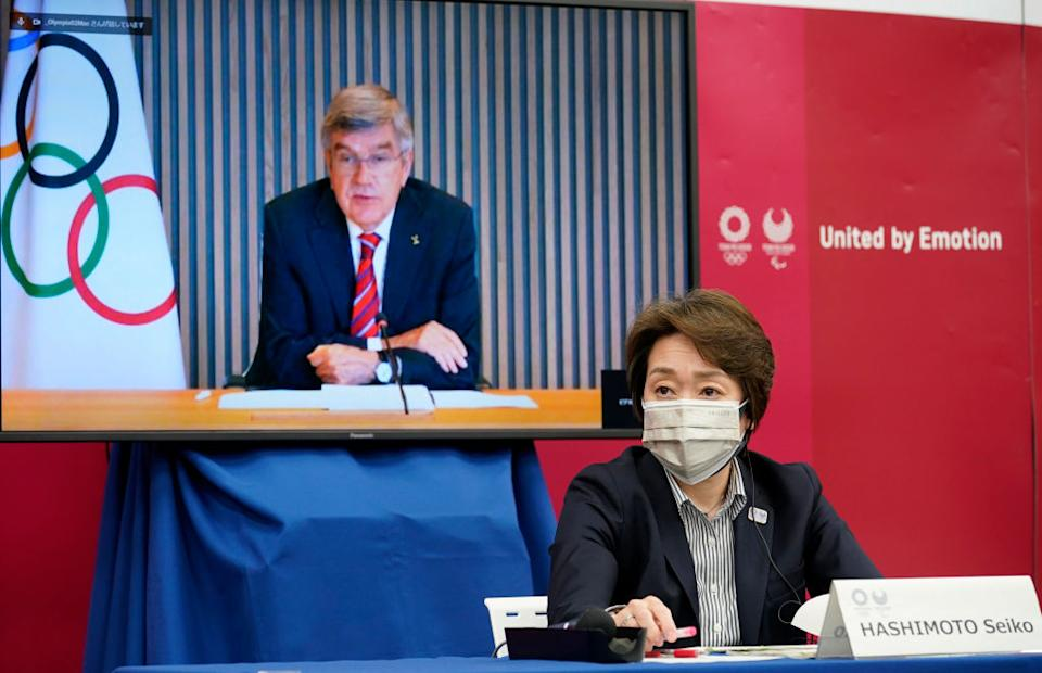 International Olympic Committee (IOC) president Thomas Bach (on a screen) delivers an opening speech while Tokyo 2020 Organizing Committee president Seiko Hashimoto listens on Wednesday. Source: Getty