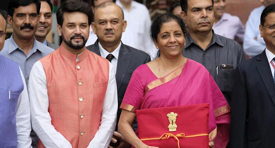 Finance Minister Nirmala Sitharaman and Anurag Thakur (left) pose for a photograph outside the North Block of the Central Secretariat building in New Delhi, India, on Friday, July 5, 2019. Photo: T  Narayan/Bloomberg via Getty Images