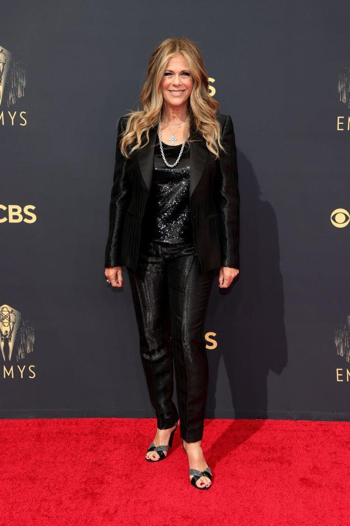 Rita Wilson on the red carpet in a black sequin suit