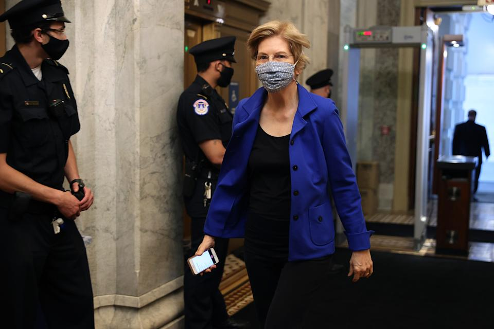 WASHINGTON, DC - MAY 18: Wearing a face mask to reduce the chance of transmission of the novel coronavirus, Sen. Elizabeth Warren (D-MA) arrives at the U.S. Capitol for a vote May 18, 2020 in Washington, DC. The Senate is back in session during the COVIDpandemic for a procedural vote on the nomination of Scott Rash to serve as federal district judge in Arizona. (Photo by Chip Somodevilla/Getty Images)