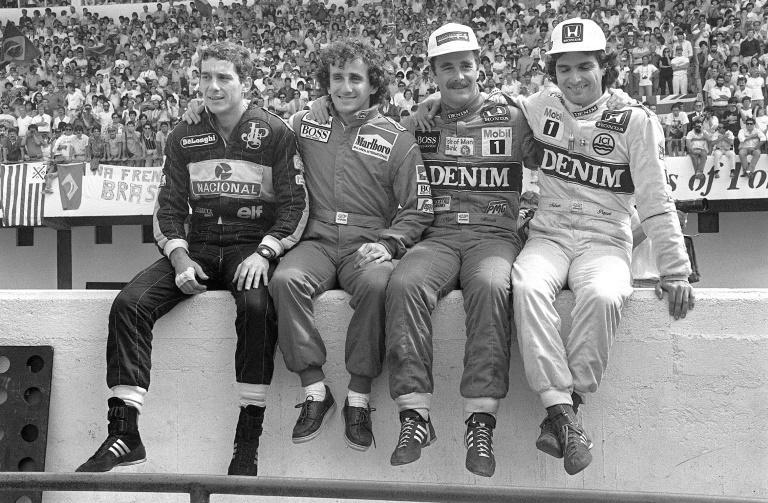 Friends and enemies: Four champions who often locked wheels pose and traded barbs, left to right, Ayrton Senna, Alain Prost, Nigel Mansell and Nelson Picquet, at the 1986 Portuguese Grand Pix at Estoril