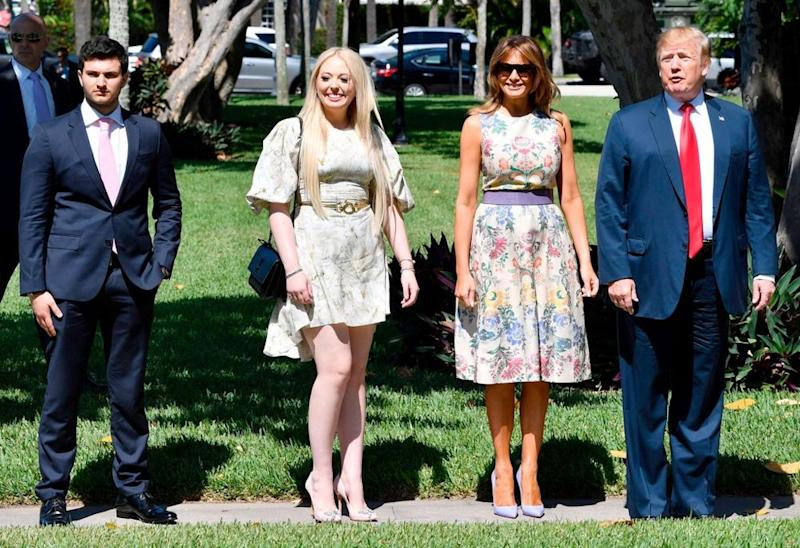 From left: Michael Boulos, Tiffany Trump, First Lady Melania Trump and President Donald Trump | NICHOLAS KAMM/AFP/Getty Images