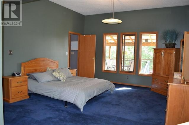 <p><span>5 Saskatoon Highway 5 East Acreage, Saskatoon, Sask.</span><br> The master bedroom is located on the main level, while the other four bedrooms are located on the lower level.<br> (Photo: Zoocasa) </p>