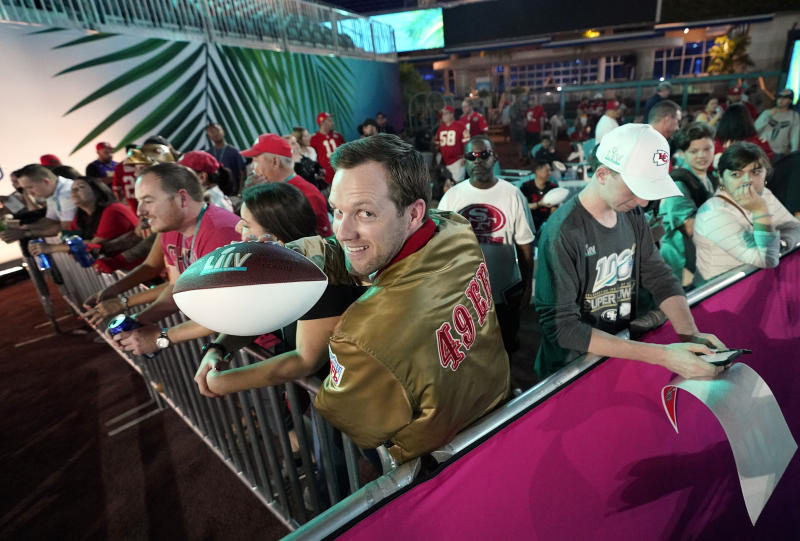 San Francisco 49ers fans wait for Opening Night for the NFL Super Bowl 54 football game Monday, Jan. 27, 2020, at Marlins Park in Miami. (AP Photo/David J. Phillip)