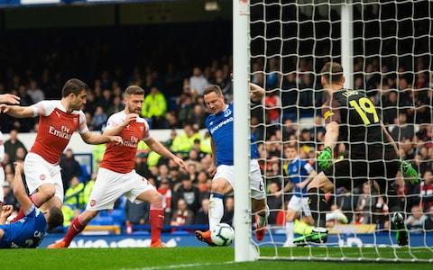 Everton's Phil Jagielka (C) scores the first goal during the English Premier League soccer match between Everton and Arsenal held at Goodison Park in Liverpool - Credit: PETER POWELL/EPA-EFE/REX