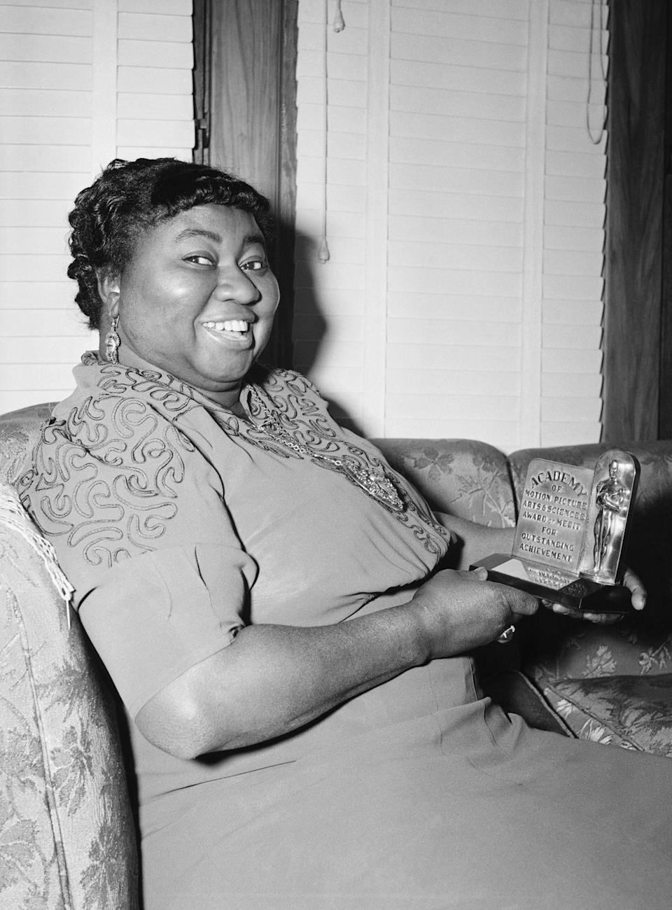 """<p>Hattie McDaniel became the <a href=""""https://www.hollywoodreporter.com/features/oscars-first-black-winner-accepted-774335"""" rel=""""nofollow noopener"""" target=""""_blank"""" data-ylk=""""slk:African American person ever to receive an Oscar"""" class=""""link rapid-noclick-resp"""">African American person ever to receive an Oscar</a> for her performance in <em><a href=""""https://www.amazon.com/Gone-Wind-Clark-Gable/dp/B002WTWQ72/ref=sr_1_3?ie=UTF8&qid=1547582421&sr=8-3&keywords=gone+with+the+wind&tag=syn-yahoo-20&ascsubtag=%5Bartid%7C10055.g.5148%5Bsrc%7Cyahoo-us"""" rel=""""nofollow noopener"""" target=""""_blank"""" data-ylk=""""slk:Gone With the Wind"""" class=""""link rapid-noclick-resp"""">Gone With the Wind</a></em>. But producers had to convince the hotel hosting the Academy Awards to even let McDaniel attend the ceremony. She was allowed in, but she had to sit at a segregated table away from her co-stars. </p>"""