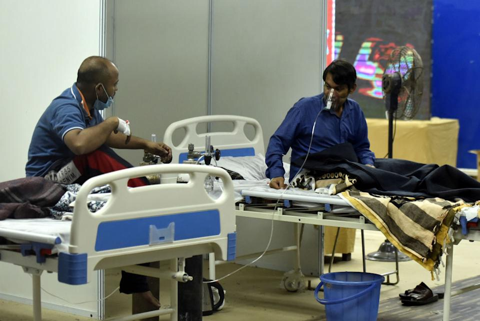 Patients at temporary Covid Care Centre at Commonwealth Games Village near Akshardham Temple in New Delhi, India.