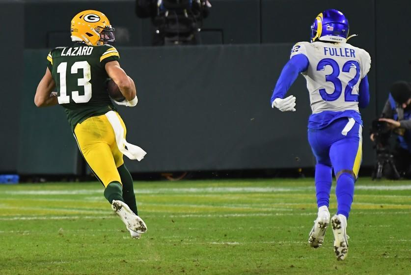 GREEN BAY, WISCONSIN JANUARY 16, 2021-Packers receiver Allen Lazard beats Rams safety Jordan Fuller to the end zone for a touchdown after a catch in the 4th quarter during a playoff game at Lambeau Field in Green Bay Saturday. (Wally Skalij/Los Angeles Times)