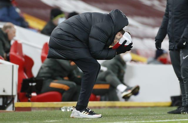 Liverpool manager Jurgen Klopp bends double holding his head in his hands
