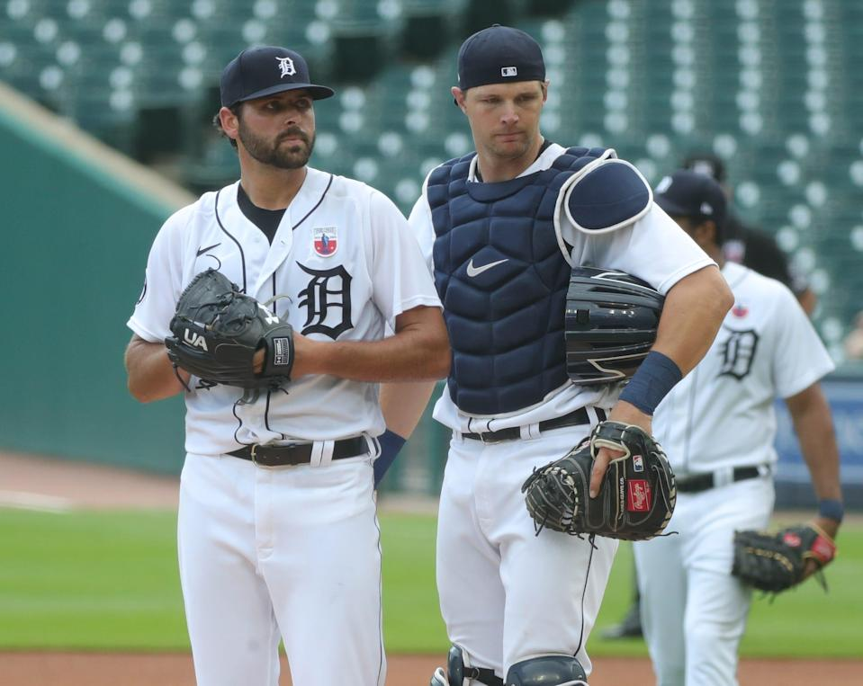 Detroit Tigers starting pitcher Michael Fulmer and catcher Grayson Greiner talk on the mound during third-inning action against the Cleveland Indians at Comerica Park, Sunday, Aug. 16, 2020.
