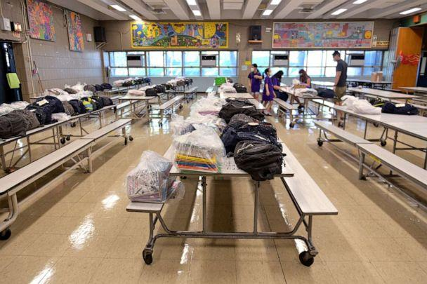 PHOTO: Rows of cafeteria tables are reserved for gifts and personal items left behind before schools were shut down to be picked up by students who just graduated at Yung Wing School P.S. 124 on June 29, 2020 in New York City. (Michael Loccisano/Getty Images, FILE)