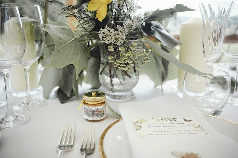 Each place card was tied with yellow ribbon onto a pot of honey from my father's bee hives, with a watercolor of the house on the label painted by a friend.