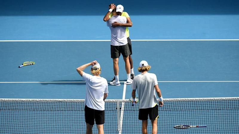Joe Salisbury and Rajeev Ram embrace after beating Luke Saville and Max Purcell in the doubles final