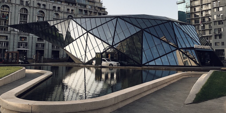 """<p>No, that's not a fine-art museum. This marvelous piece of architecture is actually a McDonald's. Yeah, let that soak in. Located in Georgia (the country, not the state), <a href=""""https://www.rferl.org/a/incredible-mcdonalds-batumi-georgia-architecture/24966153.html"""" rel=""""nofollow noopener"""" target=""""_blank"""" data-ylk=""""slk:this impressive glass structure"""" class=""""link rapid-noclick-resp"""">this impressive glass structure</a> with more than 450 glass panels was designed by architect Giorgi Khmaladze. </p>"""