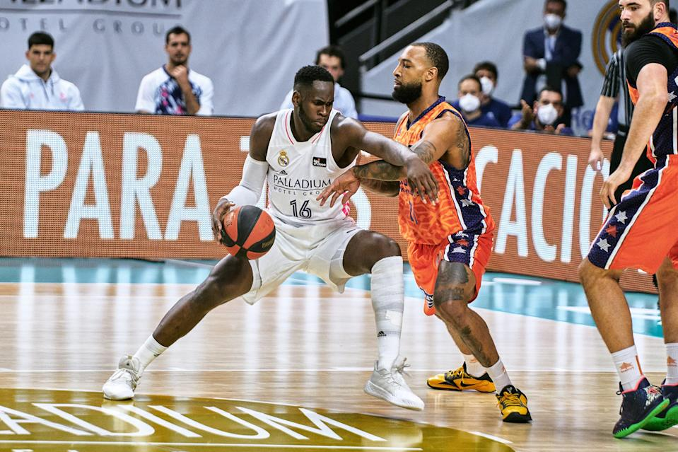 Usman Garuba of Real Madrid fights with Derrick Williams of Valencia Basket during the Liga ACB Semi-finals match between Real Madrid and Valencia at Wizink Center on June 10, 2021 in Madrid, Spain.