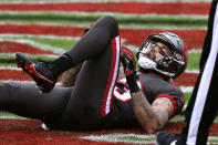 Tampa Bay Buccaneers wide receiver Mike Evans (13) reacts after injuring his leg against the Atlanta Falcons during the first half of an NFL football game Sunday, Jan. 3, 2021, in Tampa, Fla. Evans left the game. (AP Photo/Mark LoMoglio)
