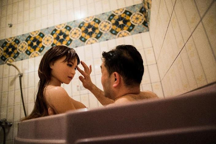 Physiotherapist Masayuki Ozaki takes a bath with his silicone sex doll Mayu, who sleeps with him in the home he shares with his wife and teenage daughter in Tokyo. (AFP Photo/Behrouz MEHRI)