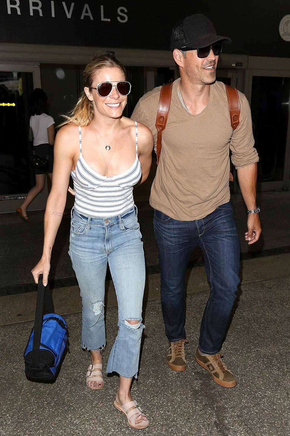 """<p>The couple came in for a landing at Los Angeles International Airport following a tropical vacation to celebrate their sixth wedding anniversary. Both commemorated the occasion with <a rel=""""nofollow"""" href=""""https://www.yahoo.com/celebrity/leann-rimes-pens-touching-tribute-224800976.html"""" data-ylk=""""slk:gushy posts on social media;outcm:mb_qualified_link;_E:mb_qualified_link;ct:story;"""" class=""""link rapid-noclick-resp yahoo-link"""">gushy posts on social media</a>, natch. (Photo: AKM-GSI) </p>"""