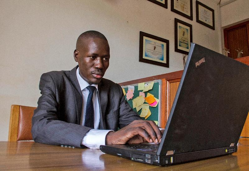 Gerald Abila's tech-savvy legal aid project, Barefoot Law, has helped hundreds of thousands with advice (AFP Photo/Isaac Kasamani)