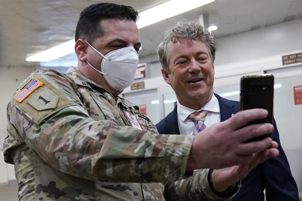 Sen. Rand Paul, R-Ky., poses for a photo with Vincent Scalise of the New York National Guard on Capitol Hill in Washington, Friday, Feb. 12, 2021, on the fourth day of the second impeachment trial of former President Donald Trump. (AP Photo/Susan Walsh)