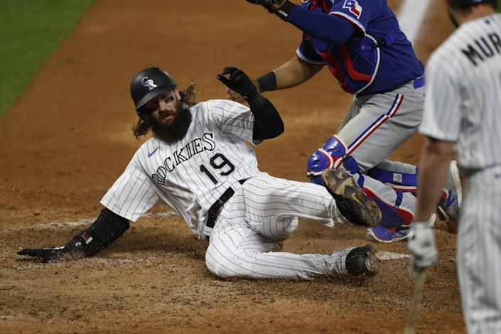 "Colorado Rockies right fielder Charlie Blackmon slides into home against the Texas Rangers on Aug. 15. <span class=""copyright"">(David Zalubowski / Associated Press)</span>"