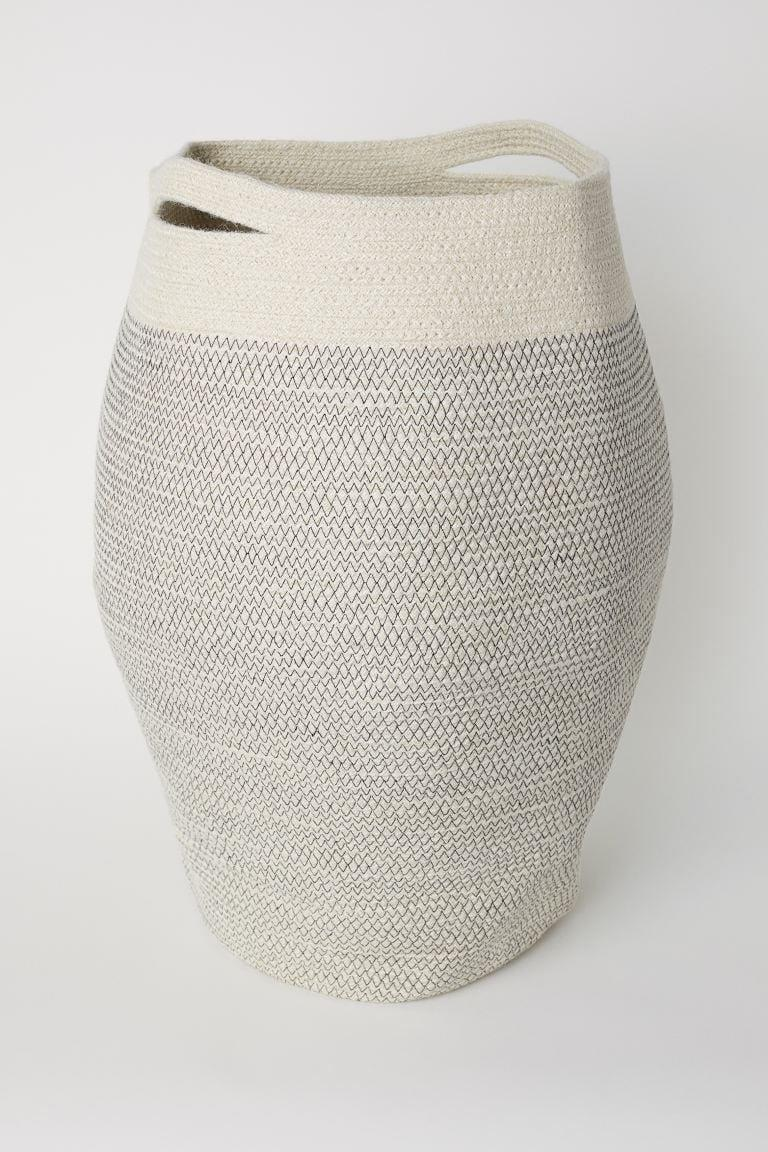 "<p>This <a href=""https://www.popsugar.com/buy/HampM-Jute-Laundry-Basket-489495?p_name=H%26amp%3BM%20Jute%20Laundry%20Basket&retailer=www2.hm.com&pid=489495&price=35&evar1=casa%3Aus&evar9=45784601&evar98=https%3A%2F%2Fwww.popsugar.com%2Fhome%2Fphoto-gallery%2F45784601%2Fimage%2F47575736%2FHM-Jute-Laundry-Basket&list1=shopping%2Cproducts%20under%20%2450%2Cdecor%20inspiration%2Caffordable%20shopping%2Chome%20shopping&prop13=api&pdata=1"" class=""link rapid-noclick-resp"" rel=""nofollow noopener"" target=""_blank"" data-ylk=""slk:H&amp;M Jute Laundry Basket"">H&amp;M Jute Laundry Basket</a> ($35) is great for storage.</p>"