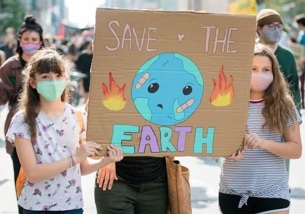 People attend a climate change protest in Montreal on Saturday, September 26, 2020. (Graham Hughes/The Canadian Press - image credit)