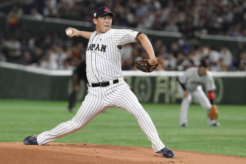 Japan starting pitcher Shun Yamaguchi delivers a pitch against South Korea in the first inning of their Premier12 baseball tournament final game at Tokyo Dome in Tokyo, Sunday, Nov. 17, 2019. (AP Photo/Toru Takahashi)