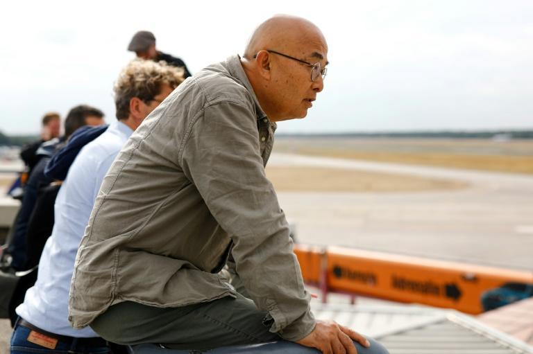 Chinese dissident and writer Liao Yiwu, waits in Berlin for the arrival of his friend Liu Xia