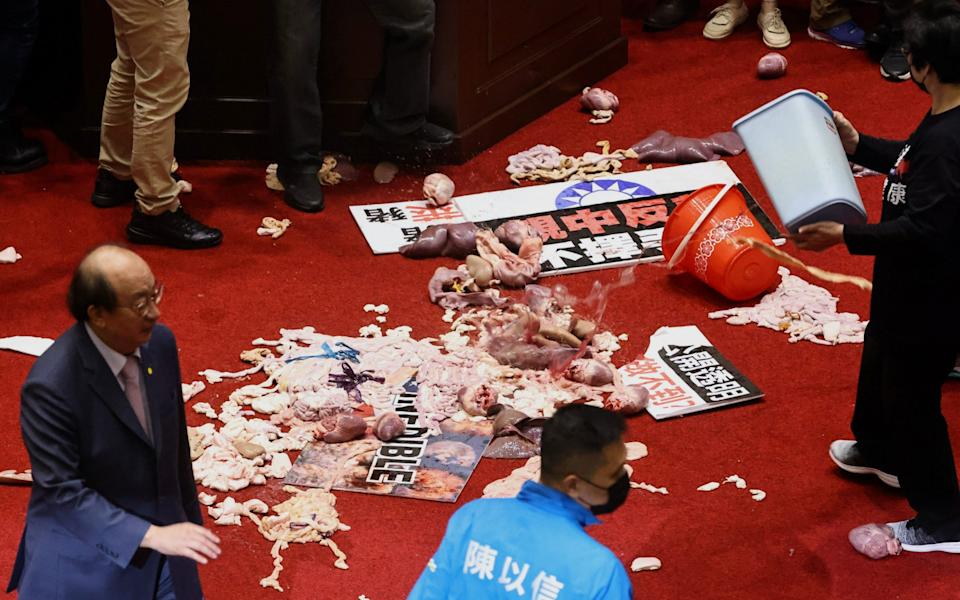 Pork intestines are seen during a scuffle in the parliament  - REUTERS
