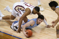 North Carolina guard Andrew Platek (3) gathers the ball as Florida State guard M.J. Walker (23) closes in during the first half of an NCAA college basketball game in the semifinal round of the Atlantic Coast Conference tournament in Greensboro, N.C., Friday, March 12, 2021. (AP Photo/Gerry Broome)