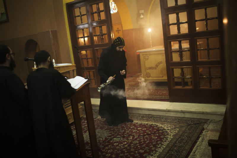 A priest purifies the church with incense during prayer at Al-Mahraq monastery in Assiut, Upper Egypt, Tuesday, Aug. 6, 2013. Islamists may be on the defensive in Cairo, but in Egypt's deep south they still have much sway and audacity: over the past week, they have stepped up a hate campaign against the area's Christians. Blaming the broader Coptic community for the July 3, 2013 coup that removed Islamist President Mohammed Morsi, Islamists have marked Christian homes, stores and churches with crosses and threatening graffiti. (AP Photo/Manu Brabo)