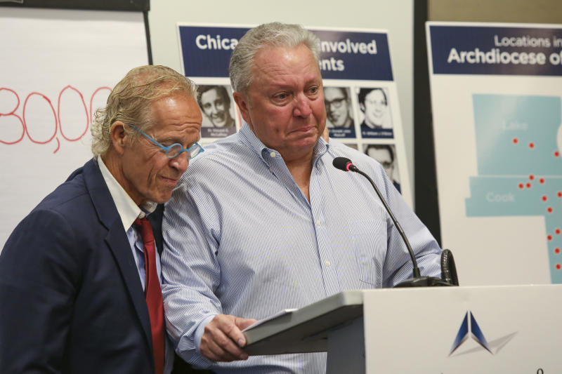 Jeff Anderson, an attorney for victims of sexual abuse by clergy, is joined by abuse victim Joe Iacono as he speaks during a press conference in Chicago, Sept. 17, 2019. Anderson says the Roman Catholic Archdiocese of Chicago has paid $80 million in settlements to clients represented by his law firm alone since 2000. Anderson told reporters in Chicago Tuesday, Sept. 17, 2019 it's the first time he's publicly revealed a total sum of payments to 160 survivors by nearly 50 abusers over 20 years. The Minnesota-based lawyer says the payments averaged $500,000 per victim, with some payouts running into the millions of dollars.  (AP Photo/Teresa Crawford)